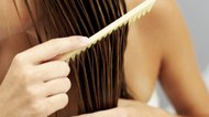 close-up of a woman combing her wet hair