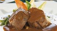 Closeup of roast beef meal in gravy