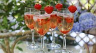 Summer cocktail with champagne, peppermint and fresh strawberrie