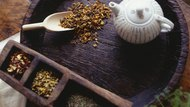 Teapot and peppermint tea lying on wooden tray, (overhead view