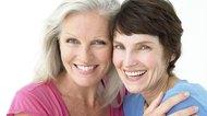 Smiling women embracing