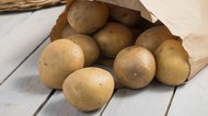 Potatoes in a brown paper bag