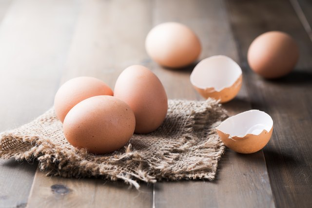 raw fresh egg on wood background
