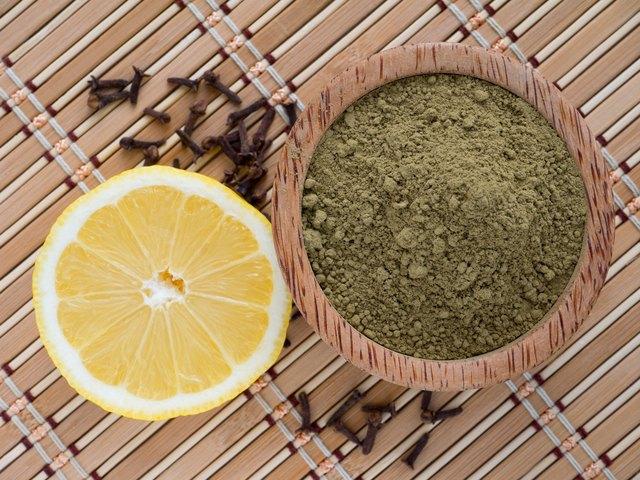 Henna powder and lemon on a bamboo mat