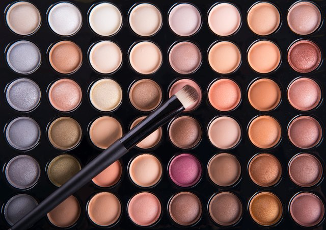 Palette of colorful eye shadows with brush