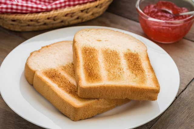 Toasts on plate and strawberry jam