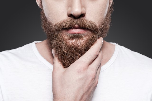 Man touching his beard