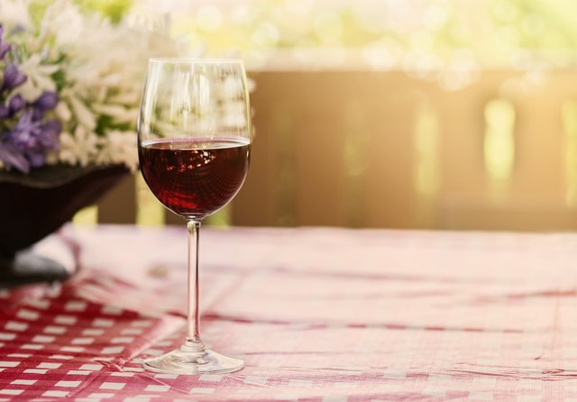 Glass of red wine on natural background