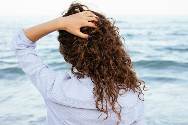 Young woman with beautiful curly hair