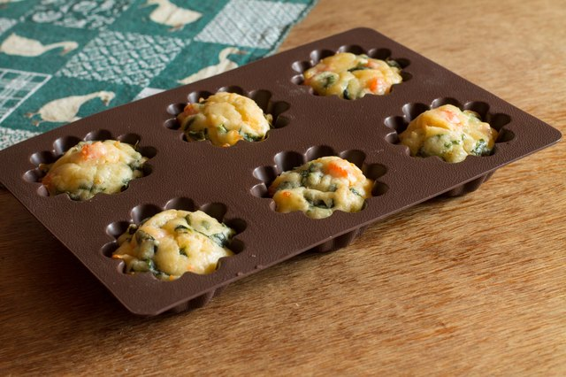 Muffin with salmon, spinach and cheese in silicone bakeware