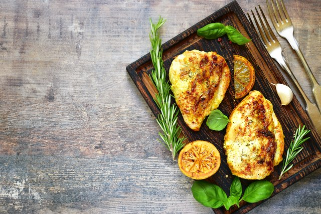 Grilled spicy chicken breast with herbs.