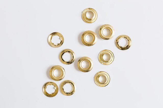 Gold eyelets on a light background.