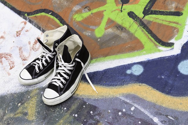 Vintage Canvas Shoes On Graffiti Background