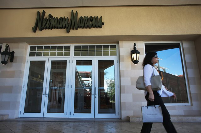 Woman walking past Nieman Marcus store