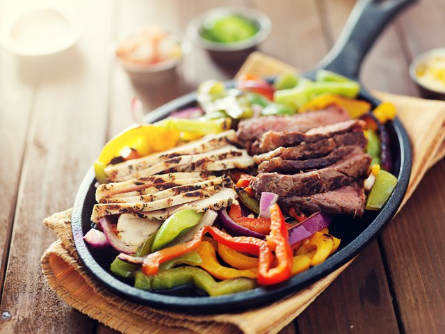 mexican food - skillet fajitas with steak and chicken