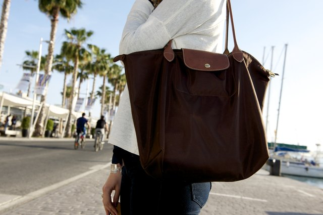 Woman carrying a Longchamp bag in the street