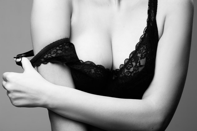 sexy woman with big breasts in black bra