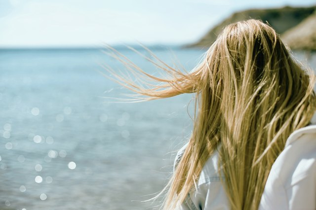 woman near beach fly hair