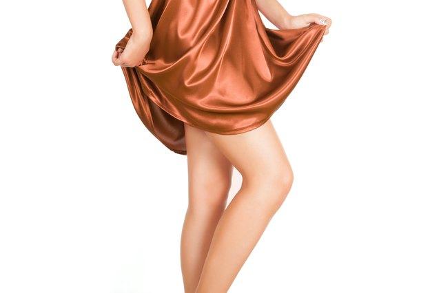 Woman wearing a brown silk dress.