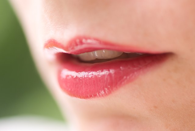 Red lipstick on thin lips