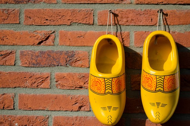 Dutch wooden shoes hanging on a wall
