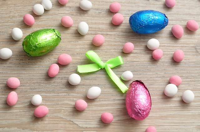 A variety of easter eggs displayed on a wooden background