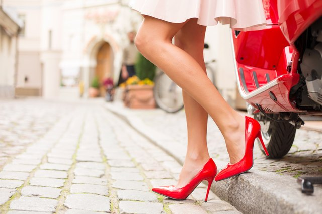 Lady in high heels walking on cobblestone