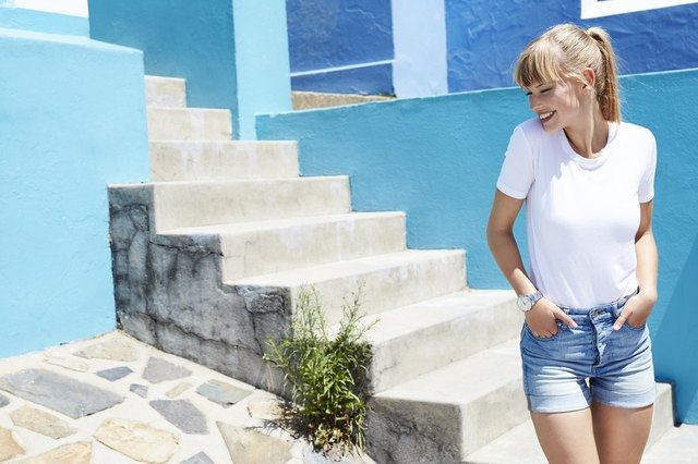 Happy young blond woman in shorts and t-shirt