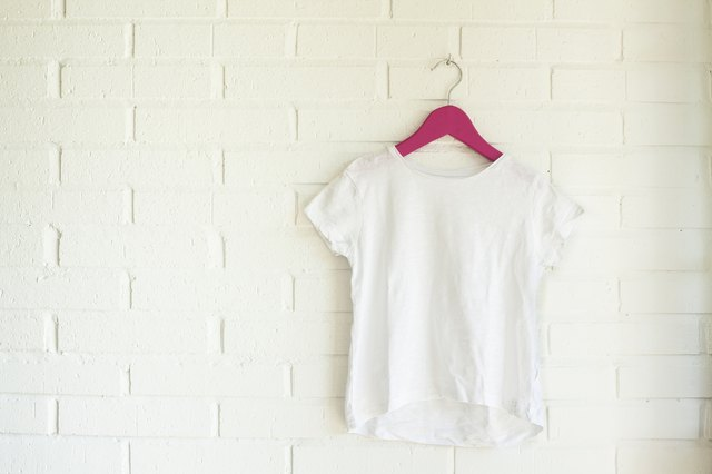 White tshirt hanging on a pink hanger
