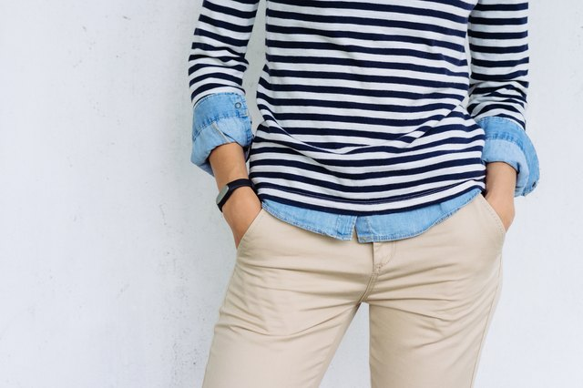 Woman in taupe pants and nautical striped top