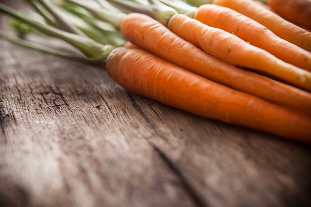 carrots on a wooden background