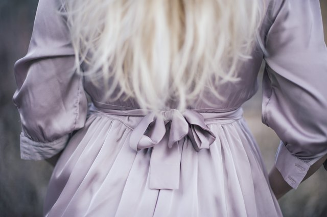 Blonde woman in a lavender dress
