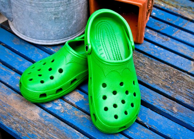 Croc sandals on a wooden deck