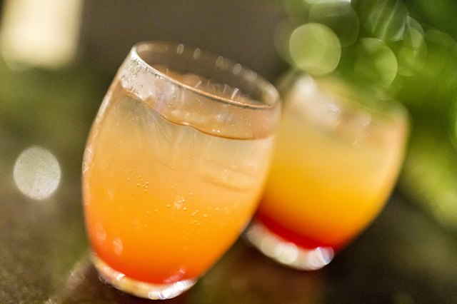Close-up of two glasses of Tequila sunrise cocktails just waiting to be savoured.
