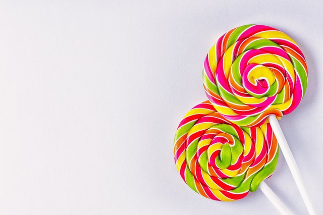 Spiral lollipops on white background