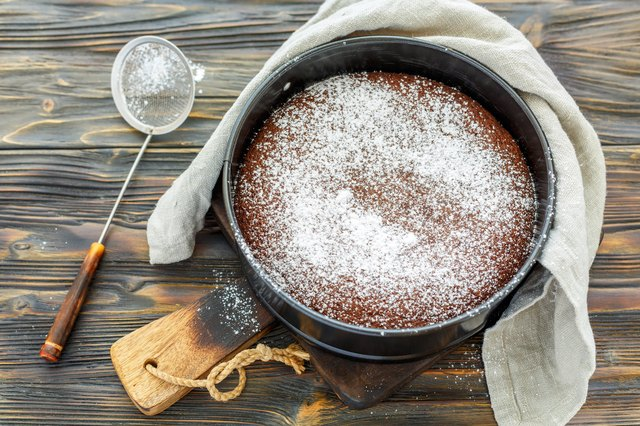 Chocolate cake sprinkled with powdered sugar.