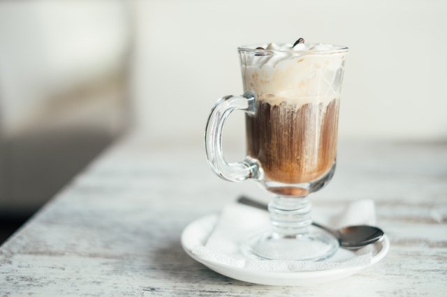 Close-up of an Irish coffee on a wooden table
