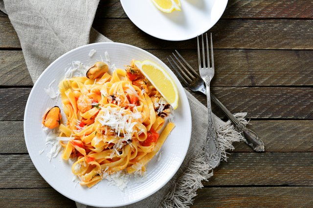 Italian pasta with seafood on a white plate