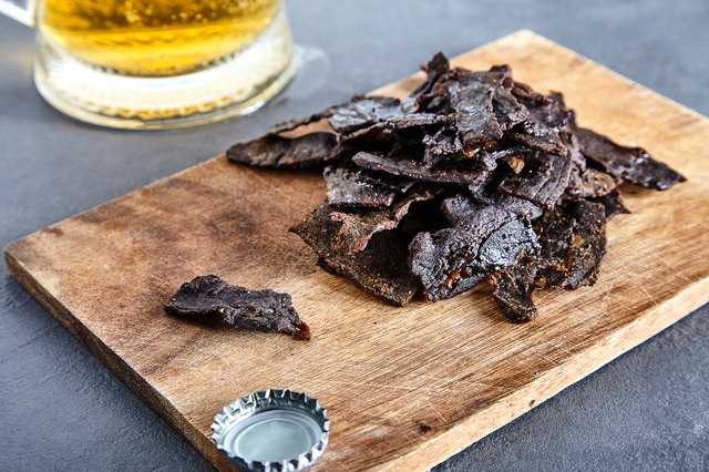 Board with homemade jerky beef and beer