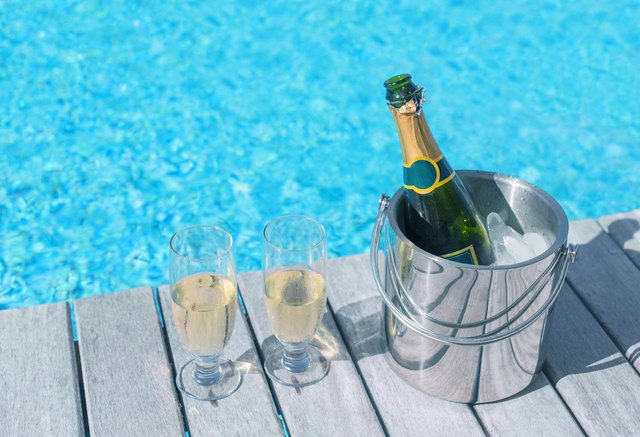 Champagne bottle in ice bucket and two glasses