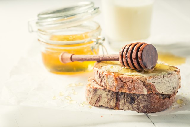 Fresh sandwich with honey for breakfast with milk