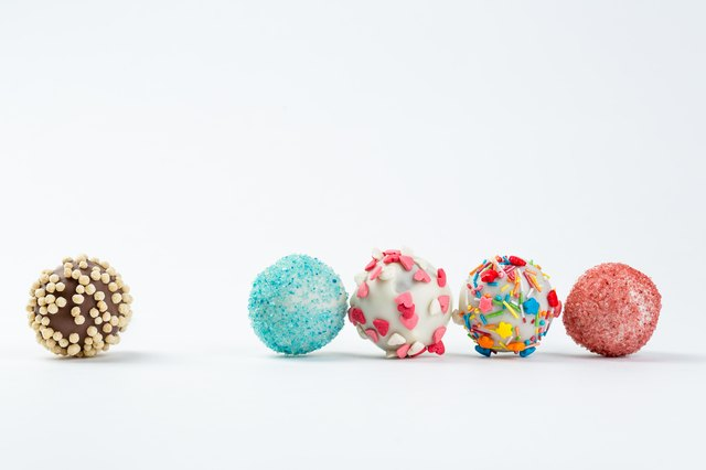 cake pops isolated lying on white table.