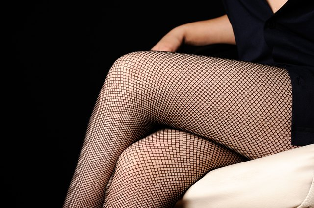 Woman legs in fishnet stockings