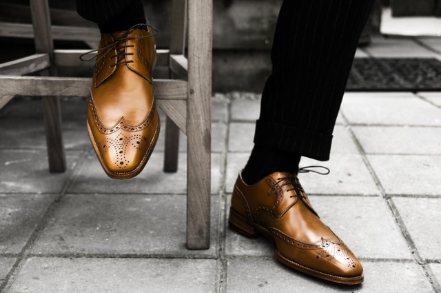 Man wearing expensive leather shoes