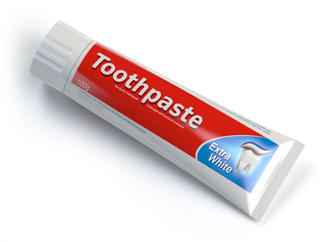 Toothpaste containers on white isolated background.