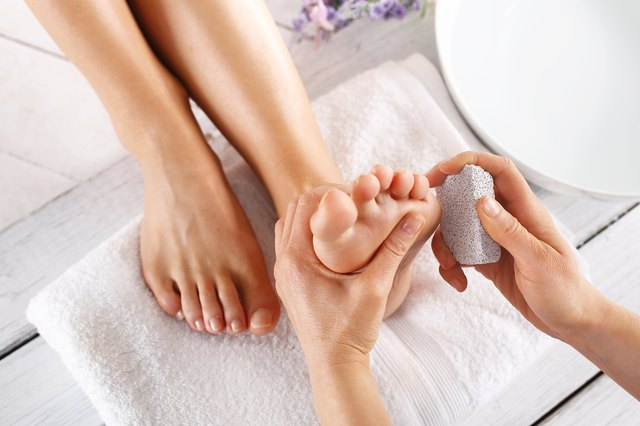 Pedicure treatment with pumice stone