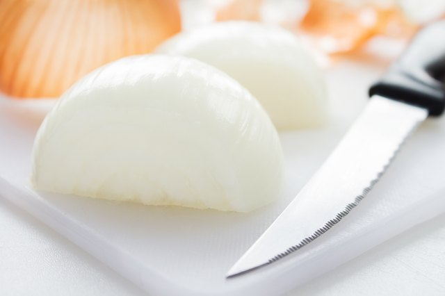 Yellow onion peeled and cut in half