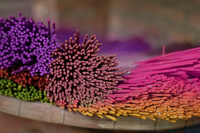 Colorful dyed aroma incense sticks made in Thailand
