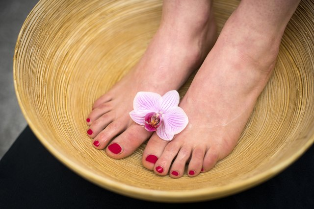 Female feet in spa bowl