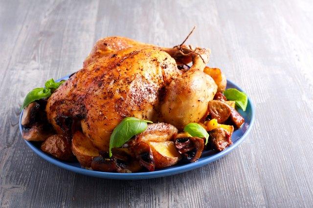 Roast chicken with potato and mushrooms